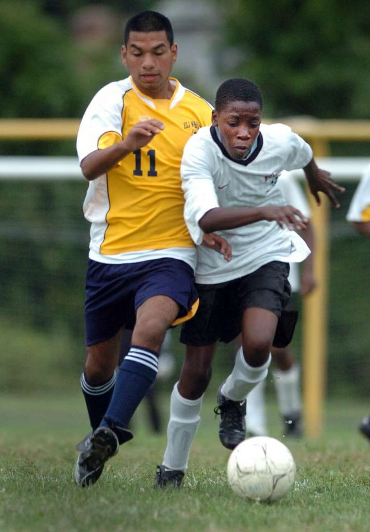 Bullard-Haven's Christopher Joseph, right, and Eli Whitney's Victor Becerra chase down the ball during the second half of Tuesday's game in Bridgeport.