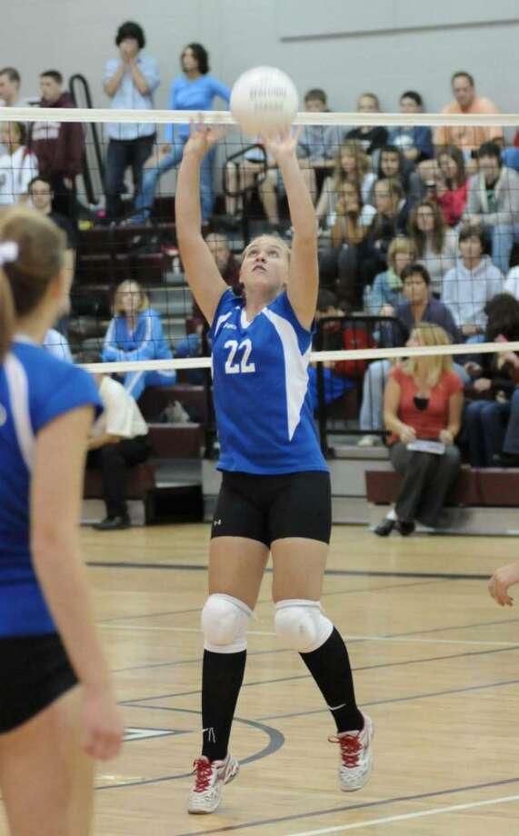 Brookfield's #22, Meghan Heron, sets up the ball.. Brookfield High School vs Bethel High School girls Volley Ball. Tuesday Sept. 29, 2009. Photo: Lisa Weir / The News-Times