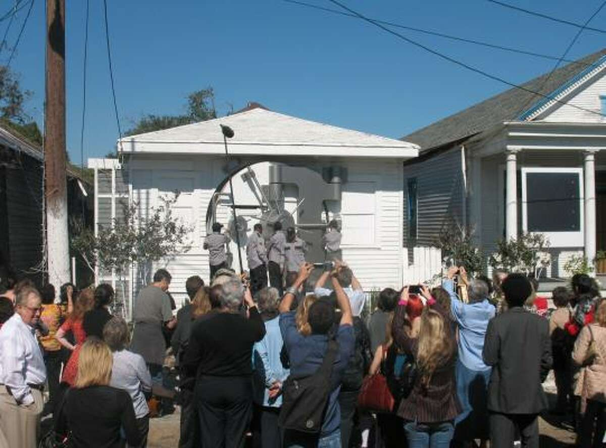 A crowd waits for the opening of Safehouse, a house transformed into a bank vault in New Orleans' St. Roch neighborhood.