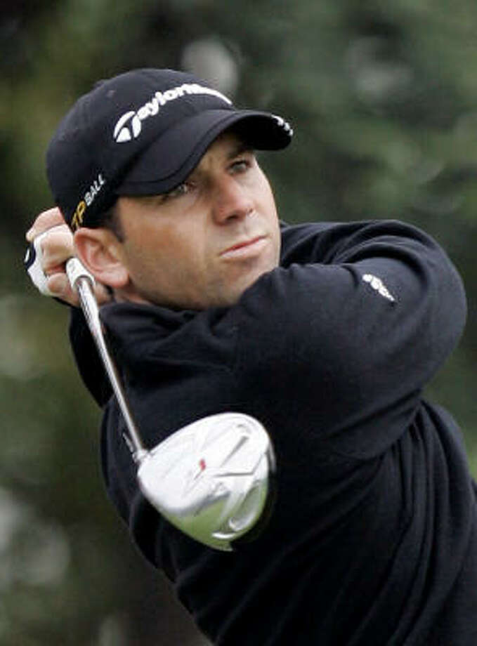 Sergio Garcia won the rain-delayed HSBC Champions to take the No. 2 spot in the world. Photo: Str, AP