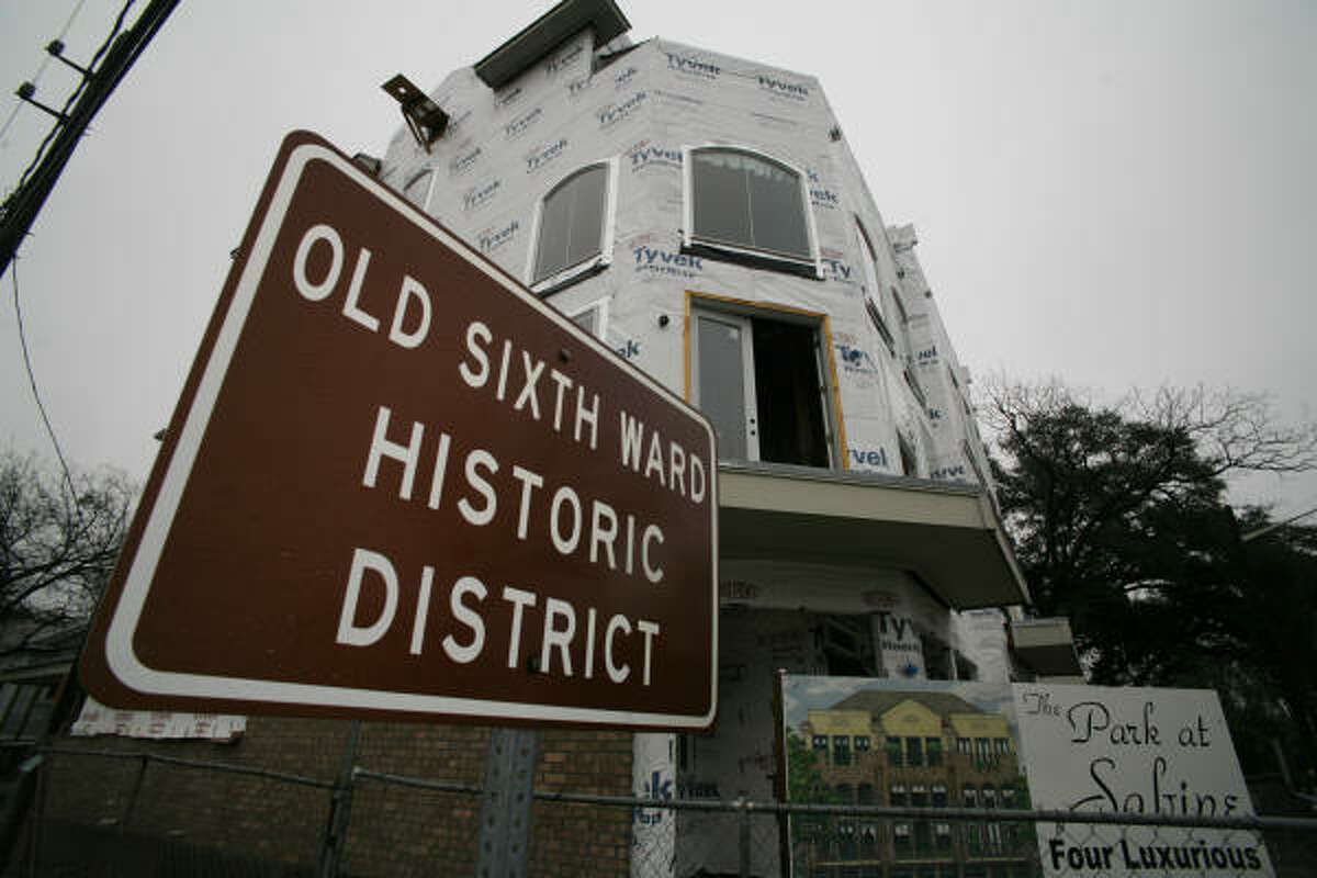 A cluster of new town houses at State and Sabine goes up near a sign denoting the neighborhood's historic pedigree.
