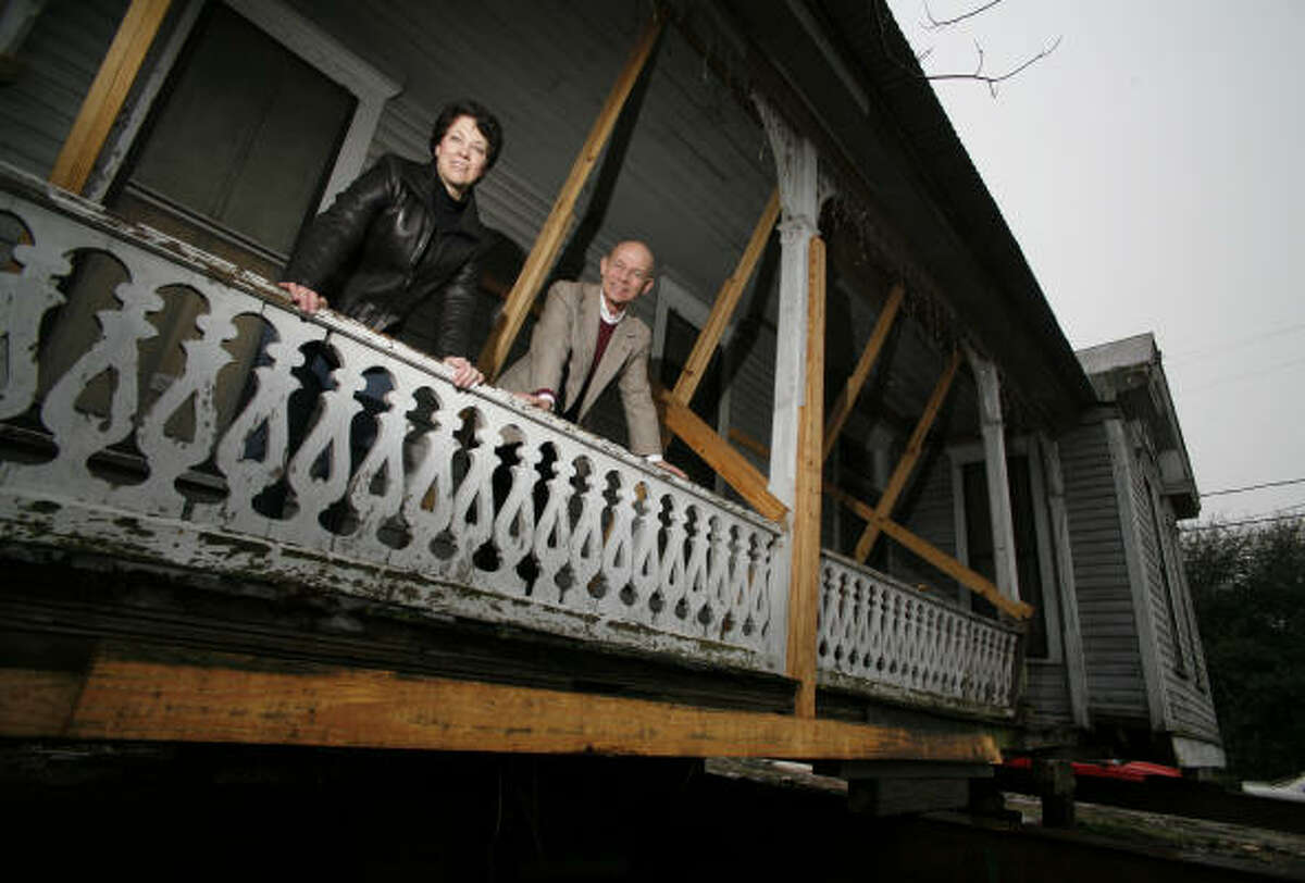 Ann Guercio and Bart Truxillo stand on the porch of a 19th century house on Lubbock that will be moved from the east side to the west side of Sabine. Guercio and her husband plan to live in the house — being moved to accommodate a parking lot — on land that Truxillo owns.