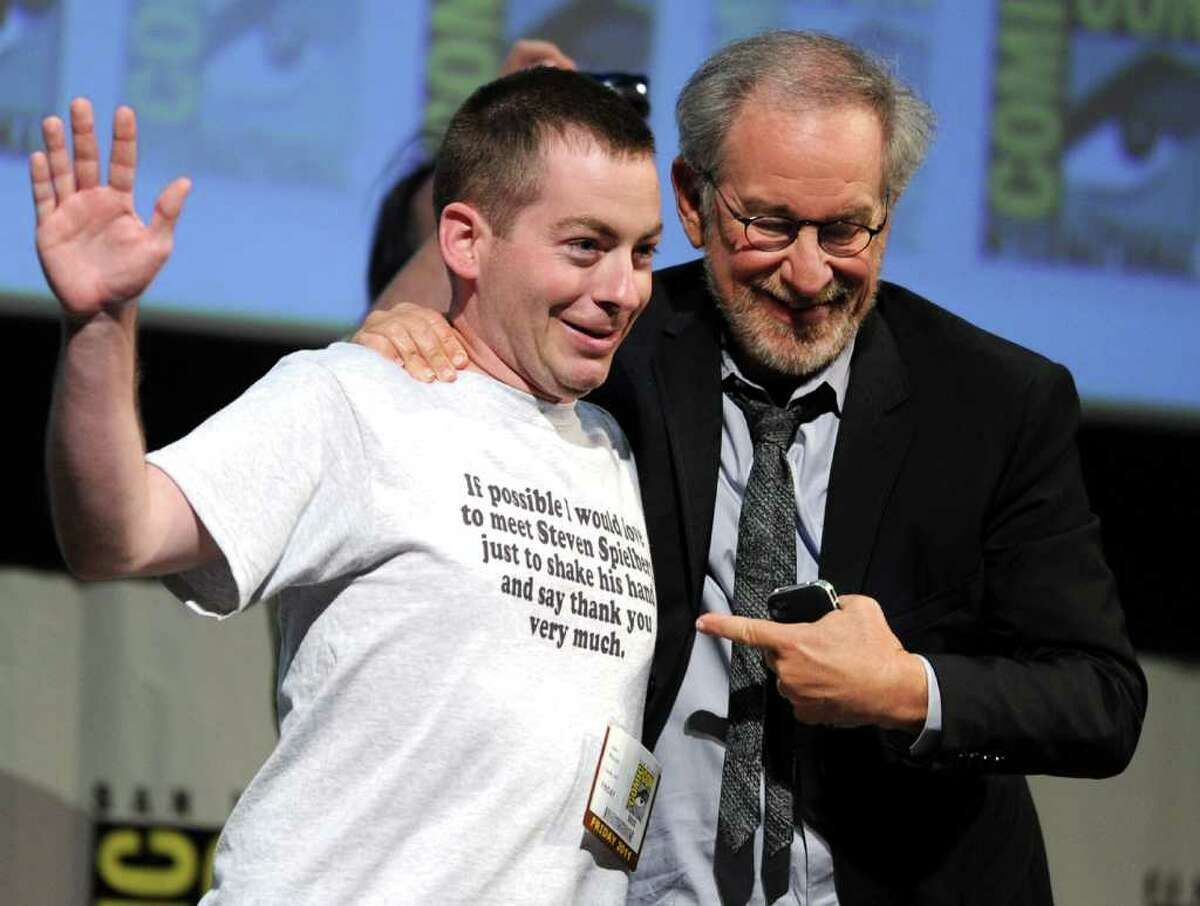 """Director/producer Steven Spielberg (right) poses with fan John Mazzoni at """"The Adventures Of Tintin"""" Panel during Comic-Con 2011 on July 22, 2011 in San Diego, California."""