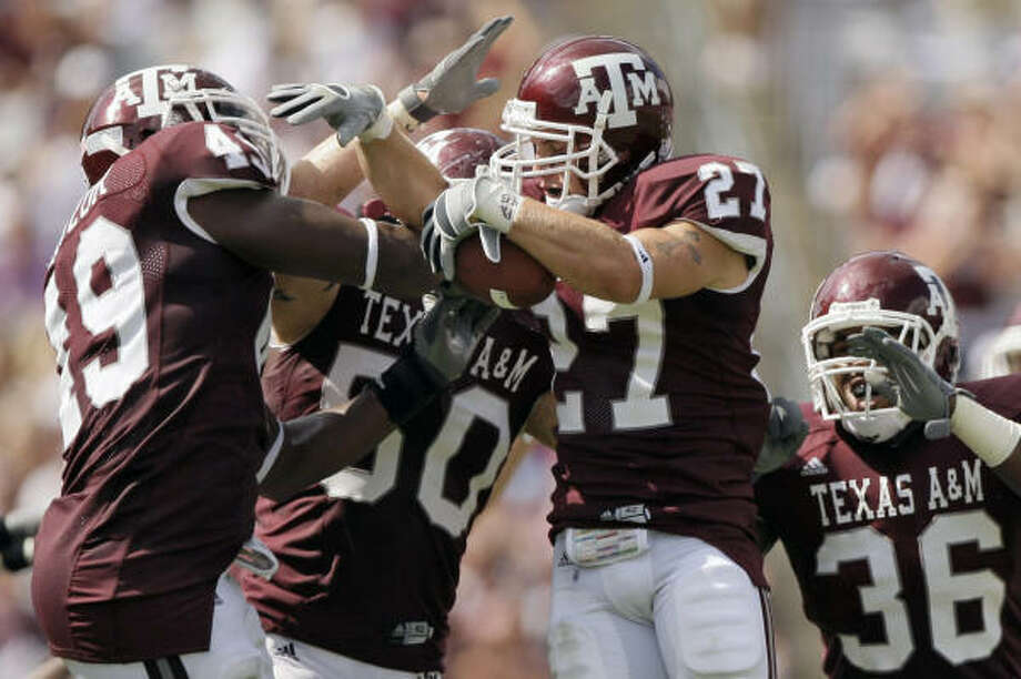 Jordan Peterson (27) recovered one of two fumbles the A&M defense forced against Fresno State. Photo: David J. Phillip, AP