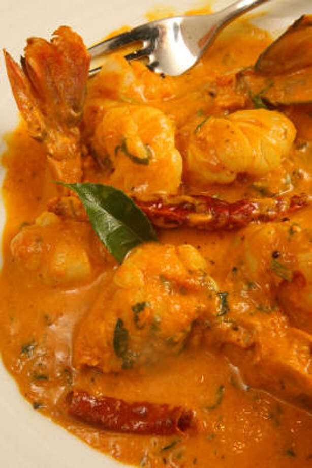 Chef Amar Singh's Goan shrimp curry doesn't skimp on the chile heat, but its coconut component provides a mellowing touch. Photo: Bill Olive, For The Chronicle