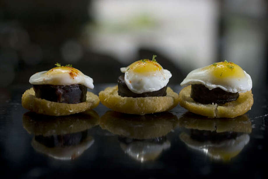 Tintos Spanish Restaurant and Wine Bar's tapas menu includes Morcilla del Caribe, a trio of blood sausage and sugar-poached quail egg served over arepa toast. Photo: Johnny Hanson :, Chronicle