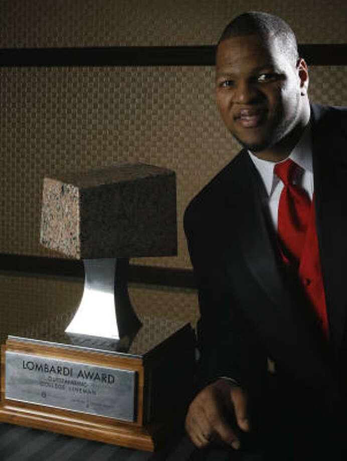 Lombardi Award winner Ndamukong Suh, a senior at Nebraska, poses with the trophy. Photo: Julio Cortez, Chronicle