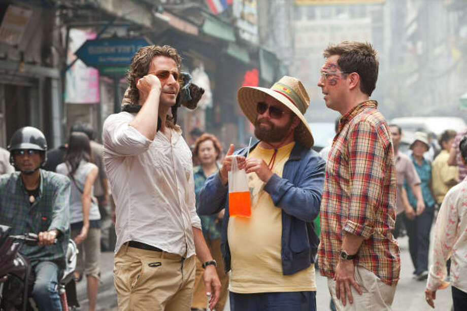 Phil (Bradley Cooper), from left, Alan (Zach Galifianakis) and Stu (Ed Helms) find themselves in Bangkok this time around. Photo: WARNER BROS.