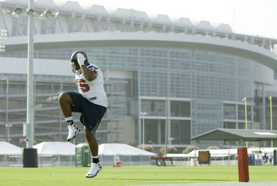 July 25: Texans first-round pick Duane Brown warms up after signing his contract just in time to join the team for their morning workout. The rookie offensive tackle, however, was an hour late to practice. Photo: Brett Coomer, Chronicle
