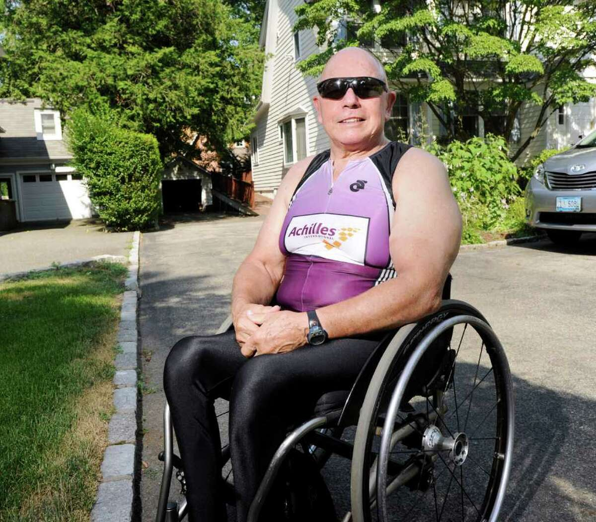 72-year old Joe Dowling, a wheelchair athlete, at his Old Greenwich home Friday afternoon, July 22, 2011. Dowling is in training for the 11th Nautica New York City Triathlon that takes place in August.