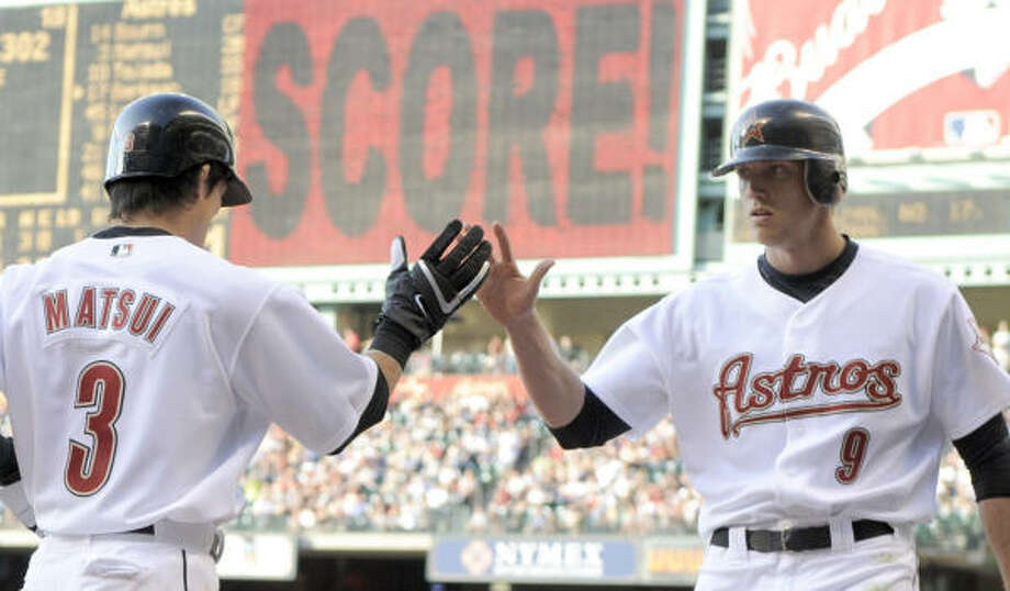 The Astros' Kazuo Matsui, left, is congratulated by Hunter Pence (9) after scoring a run in the third inning. Photo: Pat Sullivan, AP