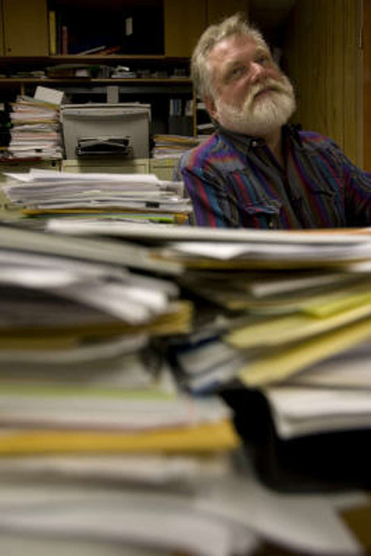 David Stall, Shoreacres city administrator, sits behind stacks of paperwork dealing with the post hurricane Ike cleanup and rebuilding.