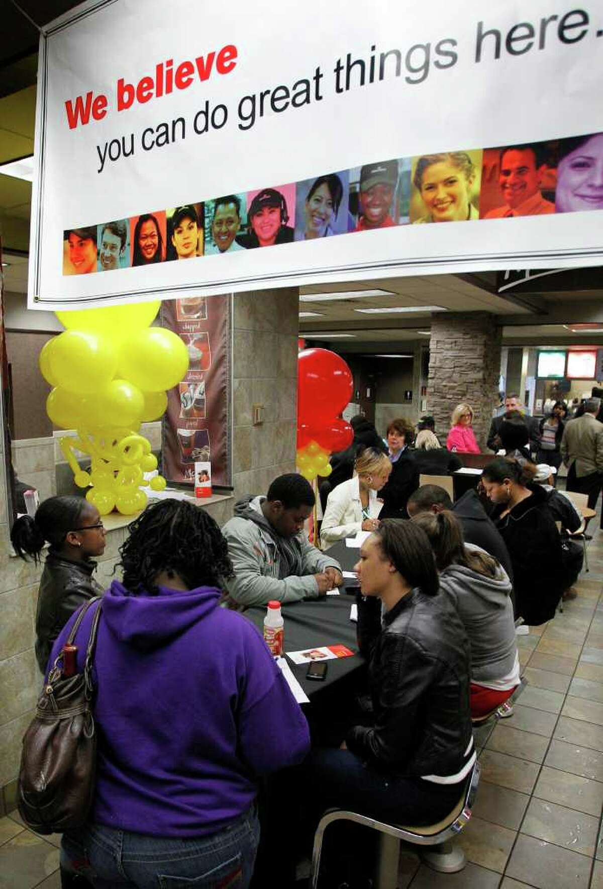 FILE - In this April 19, 2011 file photo, McDonald's National Hiring Day job seekers fill out applications before being interviewed during the lunch hour at a downtown Pittsburgh McDonald's restaurant. Strong second-quarter earnings from McDonalds and Caterpillar Friday, July 22, 2011, are just the latest example of a boom in corporate profits. But job growth is stagnant and unemployment is rising.(AP Photo/Gene J. Puskar, file)