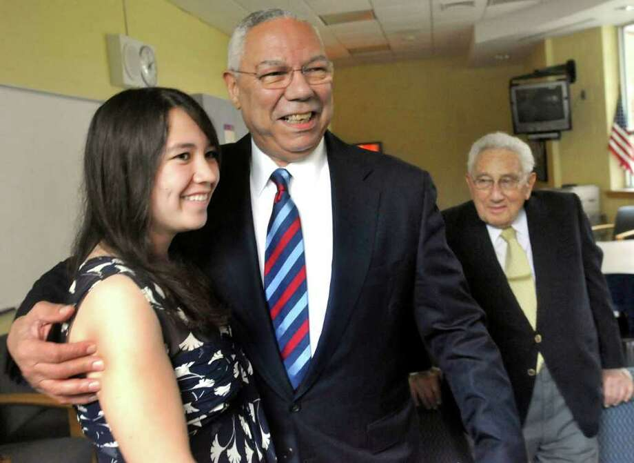 General Colin Powell poses with Monica Chin, 16, who won an essay contest at Housatonic Valley Regional High School sponsored by the Kent Memorial Library. General Powell spoke at the Kent Center School during the Kent Lecture Series at the Library, Sunday, July 3, 2011. Photo: Michael Duffy