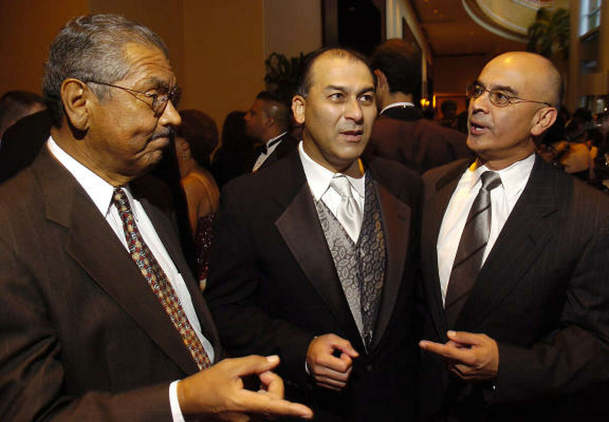 Texas state Sen. Mario Gallegos Jr., from left, Rick Jaramillo and state Rep Rick Noriega chat at the Association for the Advancement of Mexican Americans' annual gala in Houston on Oct. 6,2006.