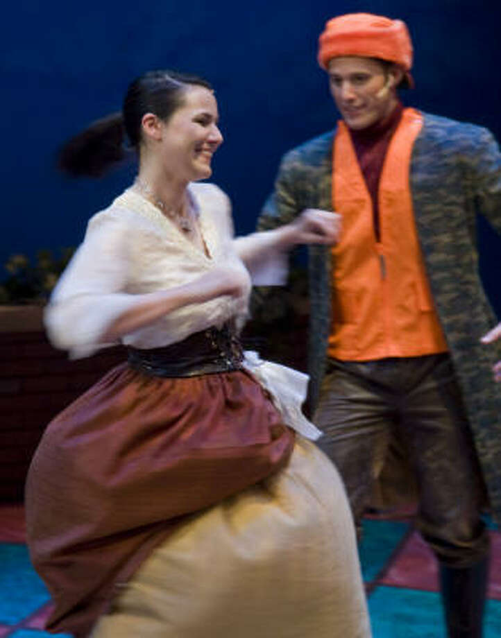 Chelsea McCurdy (Cinderella) dances with Chris Zelko (Prince Charming) during a dress rehersal of Stages Repertory Theatre's production of Panto Cinderella. Photo: Steve Ueckert, CHRONICLE