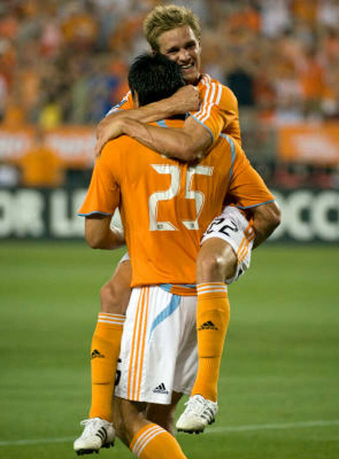 Brian Ching (25) and Stuart Holden were among 23 players selected to represent the United States at next month's Gold Cup. Photo: Smiley N. Pool, Houston Chronicle