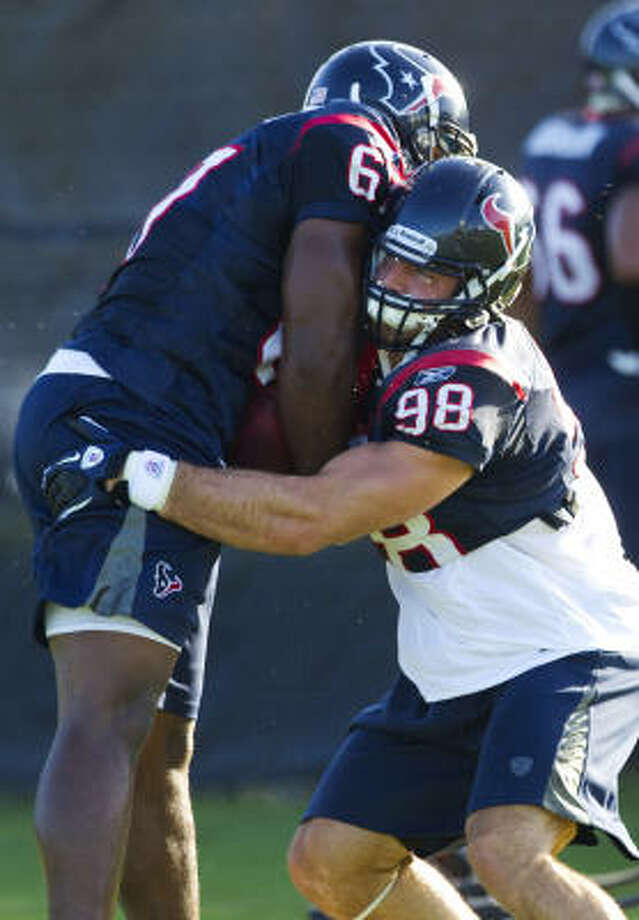 Defensive end Connor Barwin, right, hopes a better understanding of the Texans' game plan helps him improve upon a successful rookie season. Photo: Brett Coomer, Chronicle