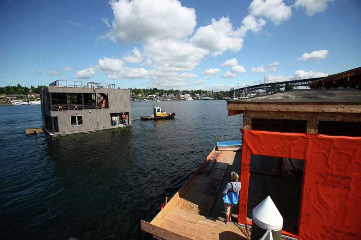 A floating home enters Wards Cove, a new floating home community in Seattle's Eastlake neighborhood on Friday, July 22, 2011. The floating home slips at Wards Cove are billed as the last new floating home spots available on Lake Union.