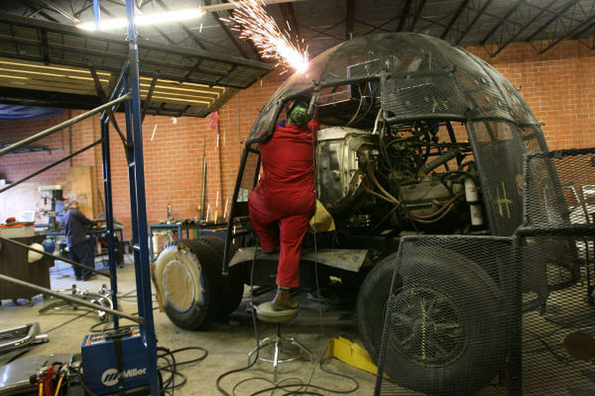 Welders work on Amber Eagle's art car, who was commissioned by local patrons Ann and Jim Harithas to create an art car for the annual parade, with the theme of the patron saint of transportation.