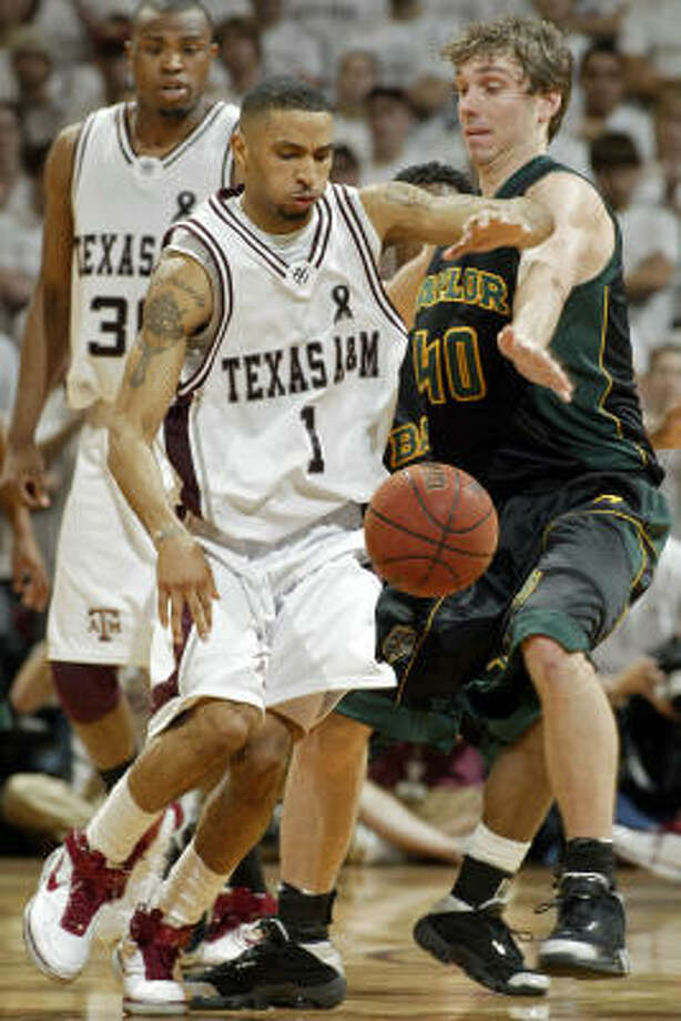 A&M guard Acie Law  and Baylor's Mark Shepherd battle for a loose ball during the second half. Law had a season-high 31 points in the Aggies' win. Photo: Paul Zoeller, AP