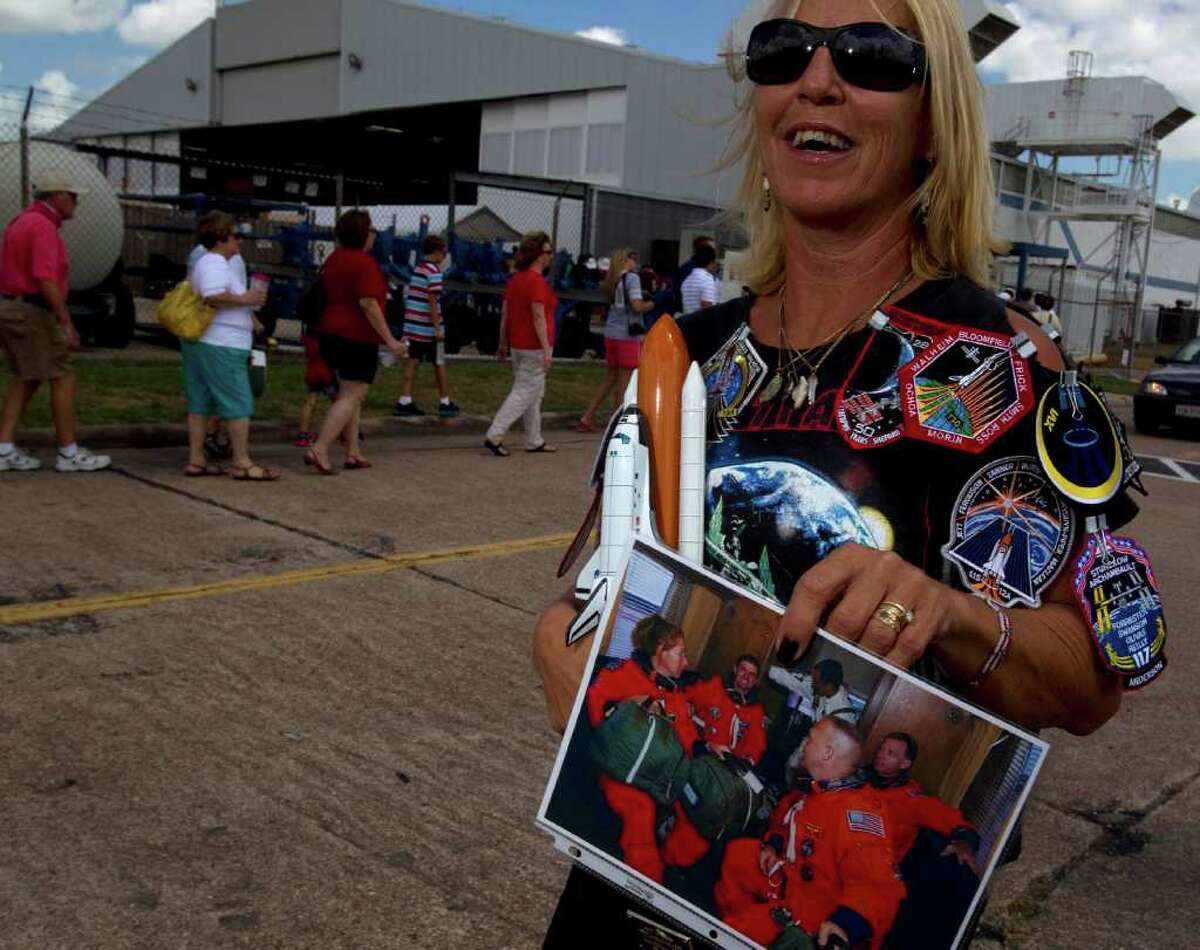 Debbie Hawkins waits in line outside NASA hanger 990 to attend a homecoming for the crew of Atlantis at Ellington Field as they performed their last act of the STS-135 mission Friday, July 22, 2011 in Houston.