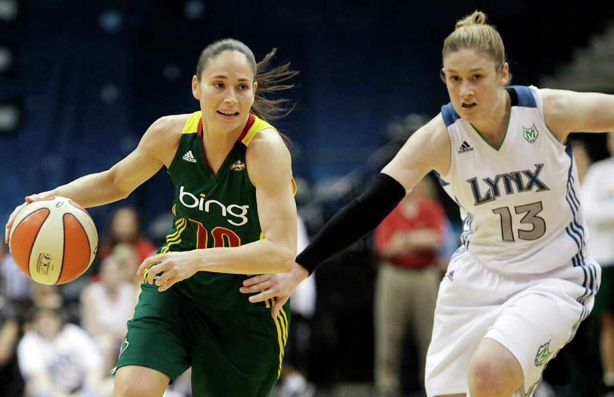 Seattle Storm guard Sue Bird drives past Minnesota Lynx guard Lindsay Whalen in the first half of an WNBA basketball game, Saturday, July 16, 2011, in Minneapolis. (AP Photo/Stacy Bengs)