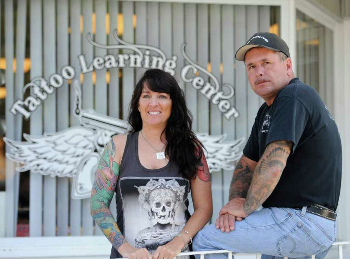 The ownership of the Tattoo Learning Center July 15, 2011, in Rotterdam, N.Y. from left are; Co-owner Jeff Looman, Co-owner Lisa Fasulo. (Skip Dickstein/ Times Union)