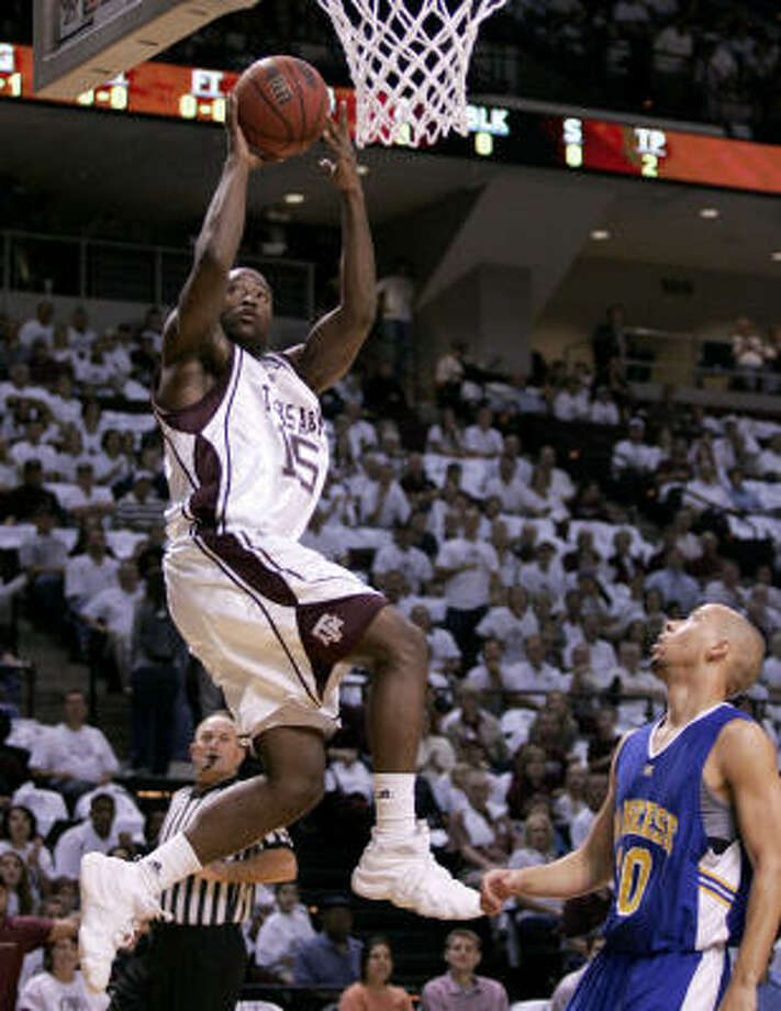 Donald Sloan (in white) and the Aggies shot 54 percent from the floor. Photo: Paul Zoeller, AP