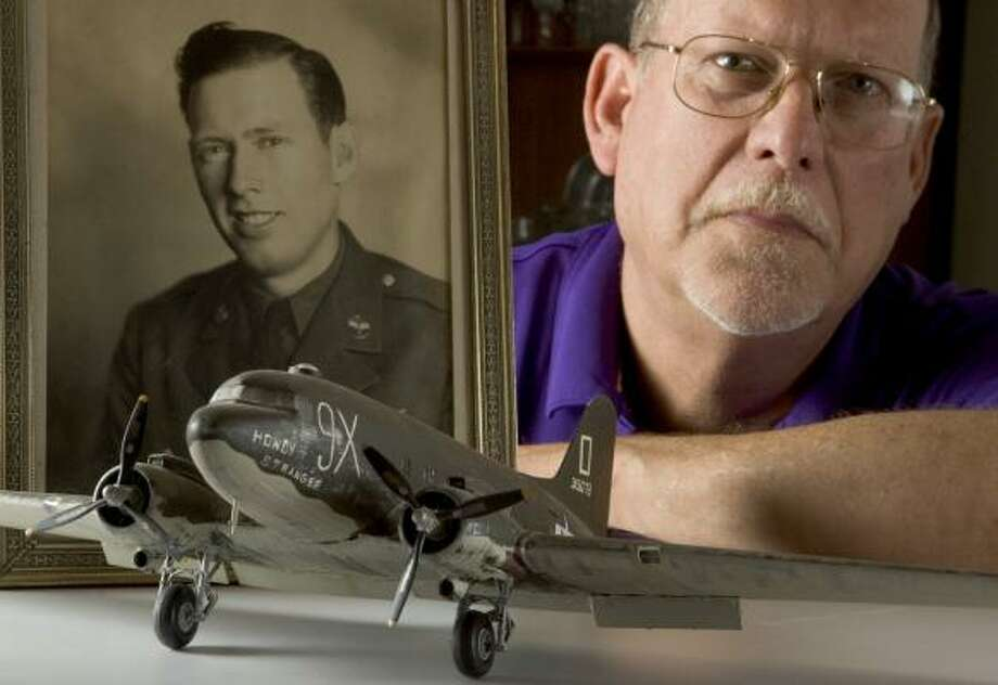 """Baytown's Chris Buckner gave this C-47 model to his dad, Joseph """"Buck"""" Buckner, who flew on one of the planes in WWII. Photo: BRETT COOMER, CHRONICLE"""
