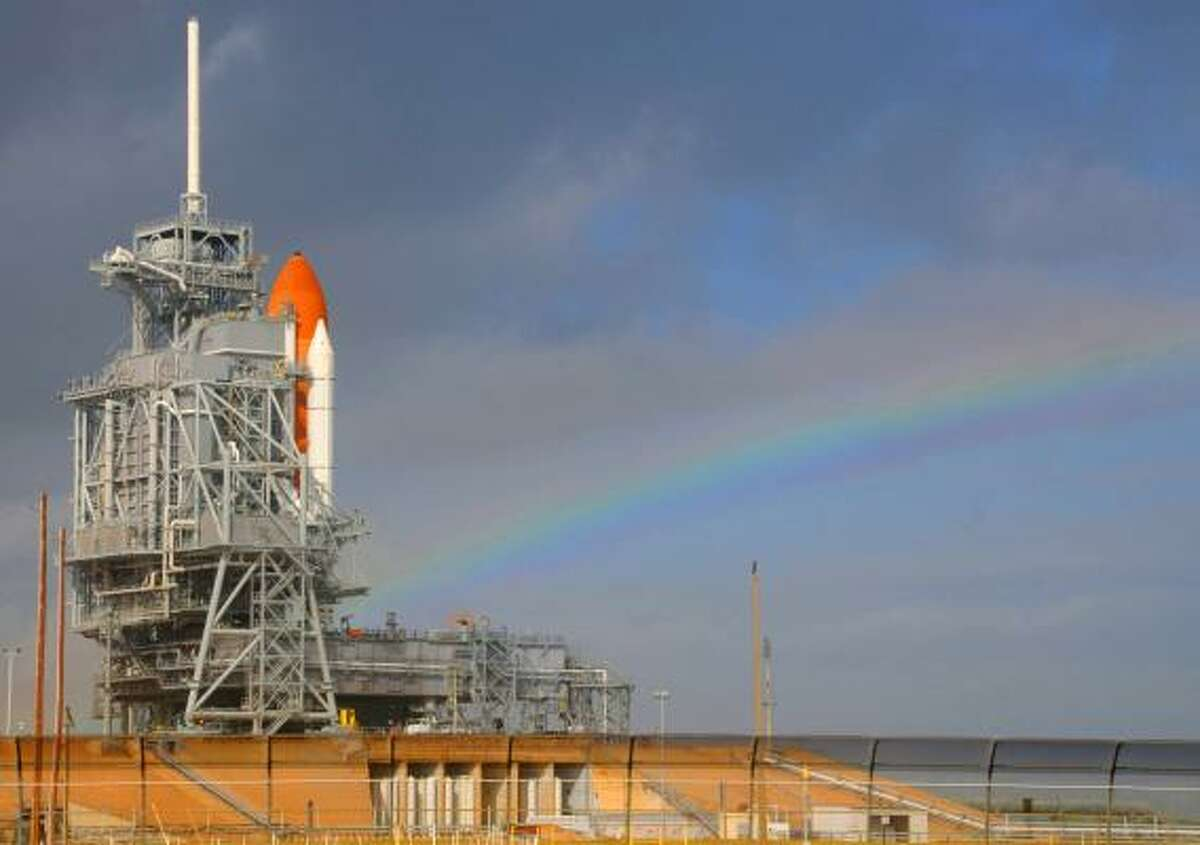 A rainbow shines on space shuttle Endeavour on Wednesday as astronauts prepare for liftoff.