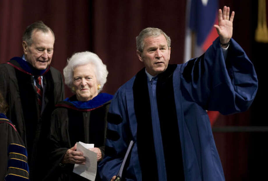 President George W. Bush, right, waves as he departs the inaugural winter commencement convocation followed by his parents, former President George H.W. Bush and his mother, Barbara, at Texas A&M University on Friday, Dec. 12, 2008, in College Station. Photo: Brett Coomer, Chronicle