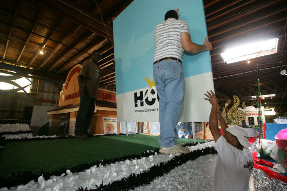FITS LIKE A GLOVE: The Houston Community Colllege float, here being put together by members of Parades Etc., is one of 70 entries into the Alief International Parade. The event is scheduled to take place at 9 a.m. Sept. 26.