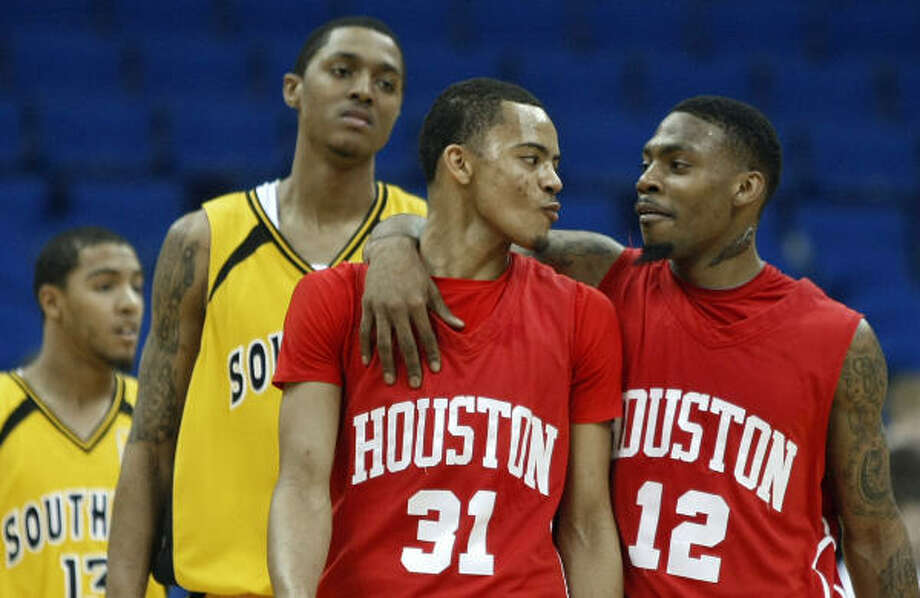 Houston's Adam Brown (31) and Aubrey Coleman (12) celebrate their 74-66 victory over Southern Miss. Photo: Stephen Holman, AP