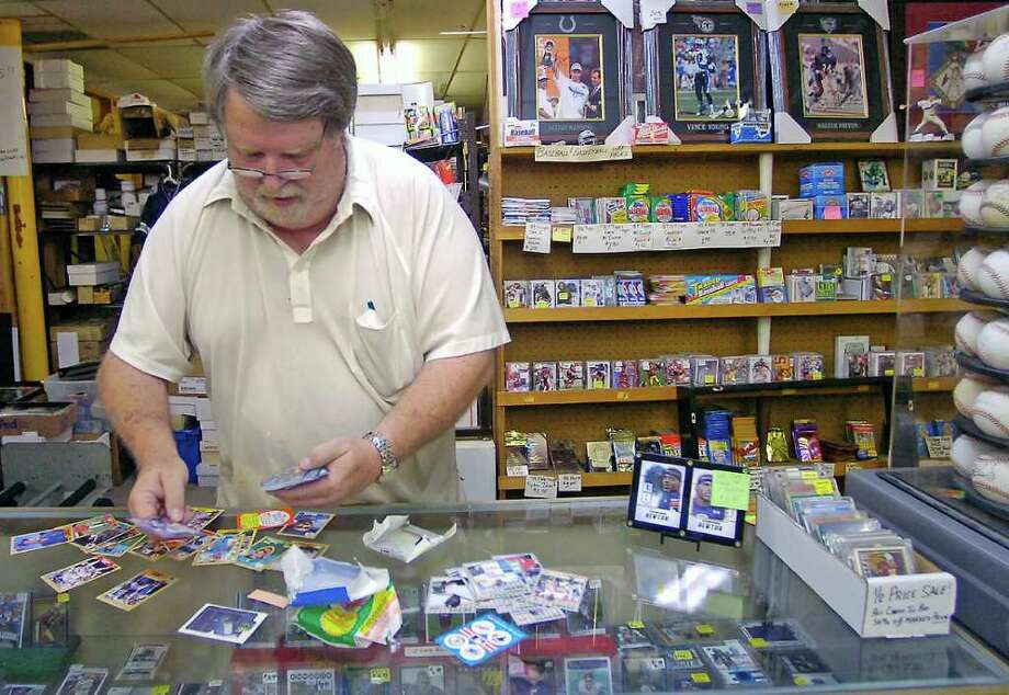 "Opening a vintage ""wax pack"" of Topps 1987 major league baseball cards, Richard Tyner, a retired coach and teacher with the Beaumont Independent School District looks to see what he got in the old bubble gum included pack that used to be sold everywhere.   Tyner has operated his sports memorabilia shop - R&D's Cards and Collectables - with baseball cards, football cards, autographed and mounted photos and jerseys since 1980.   Dave Ryan/The Enterprise Photo: Dave Ryan"
