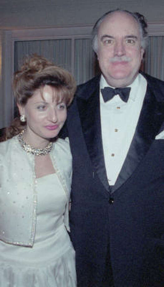 Tina LaMatta, pictured with Ugo di Portanova at a Houston opera function in 1987, receives no salary, but her husband is paid $150,000 a year. Photo: Larry Reese, Chronicle File