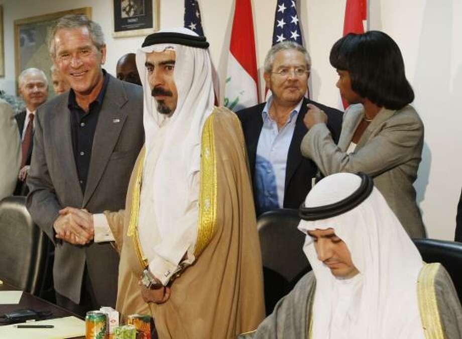 President Bush, shakes hands with Abdul-Sattar Abu Risha, who led a revolt of Sunnis against al-Qaida in Iraq, at a meeting in Anbar province Sept. 3. Abu Risha was assassinated Thursday. Photo: CHARLES DHARAPAK, ASSOCIATED PRESS