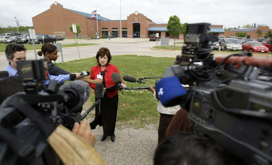 Kathy Clausen, a spokesperson for Goose Creek ISD, speaks to the media outside of the Cedar Bayou Junior School. Photo: Karen Warren, Chronicle