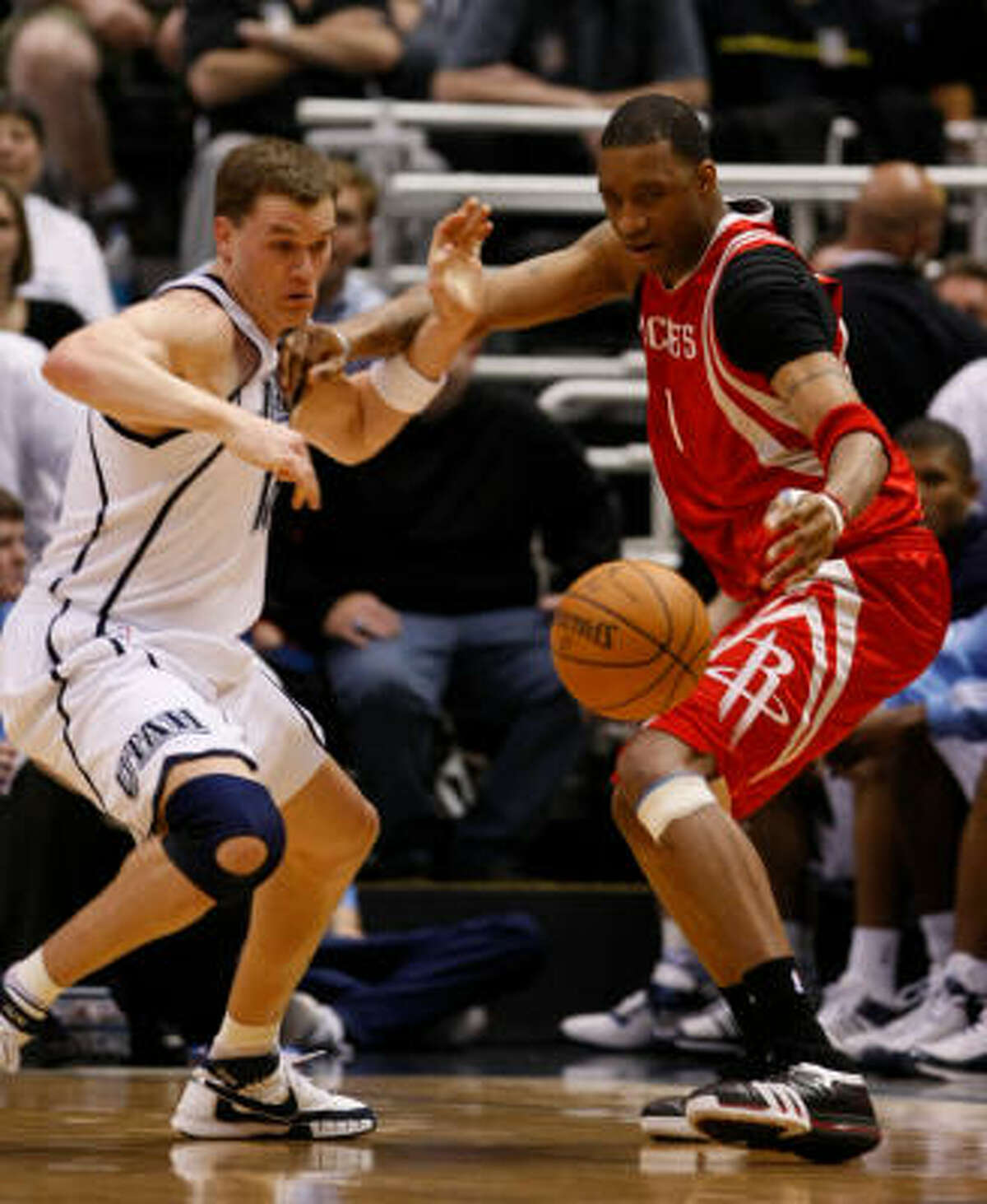 Jazz forward Matt Harpring, left, steals the ball from Rockets guard Tracy McGrady in the fourth quarter of Game 4.
