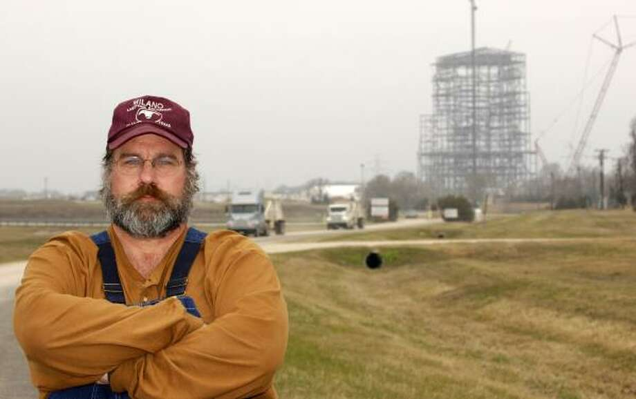 """Twenty years from now, we'll look back and say, 'Geez, why did we build a bunch of century-before-last technology when we were right on the cusp of a better way to make electricity?' "" says Paul Rolke, a Robertson County rancher against TXU's proposed coal-fired plants. Photo: BRUCE W. MOORE, FOR THE CHRONICLE"