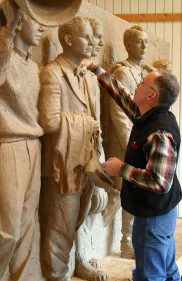 """Artist Bruce Greene works on a clay model for his bronze memorial of Baylor University's """"Immortal Ten"""" basketball team members who died in a Jan. 22, 1927, bus-train crash. Photo: Bruce Greene, BRUCE GREENE VIA WACO TRIBUNE-HERALD"""