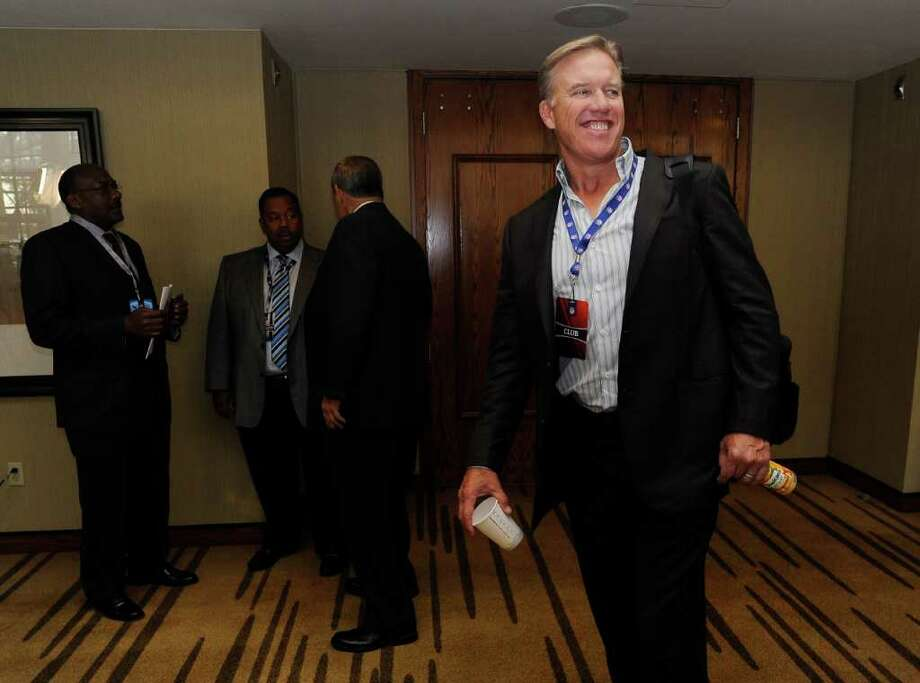 Jon Elway, executive vice president of football operations for the Denver Broncos,  arrives for a meeting Friday, July 22, 2011, in Atlanta. NFL general managers and other team executives are meeting to discuss specifics of the labor agreement approved by owners and make plans for the season while awaiting the players' vote on the deal. (AP Photo/John Amis) Photo: John Amis