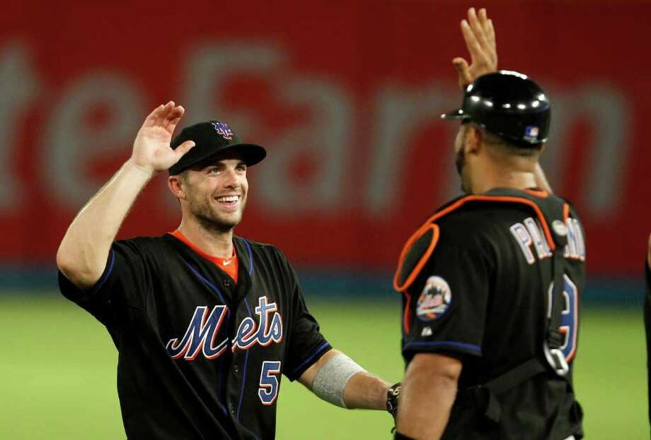 New York Mets third baseman David Wright (5) celebrates with catcher Ronny Paulino (9) after their 7-6 win over the Florida Marlins in a baseball game in Miami, Friday, July 22, 2011. (AP Photo/Lynne Sladky) Photo: Lynne Sladky