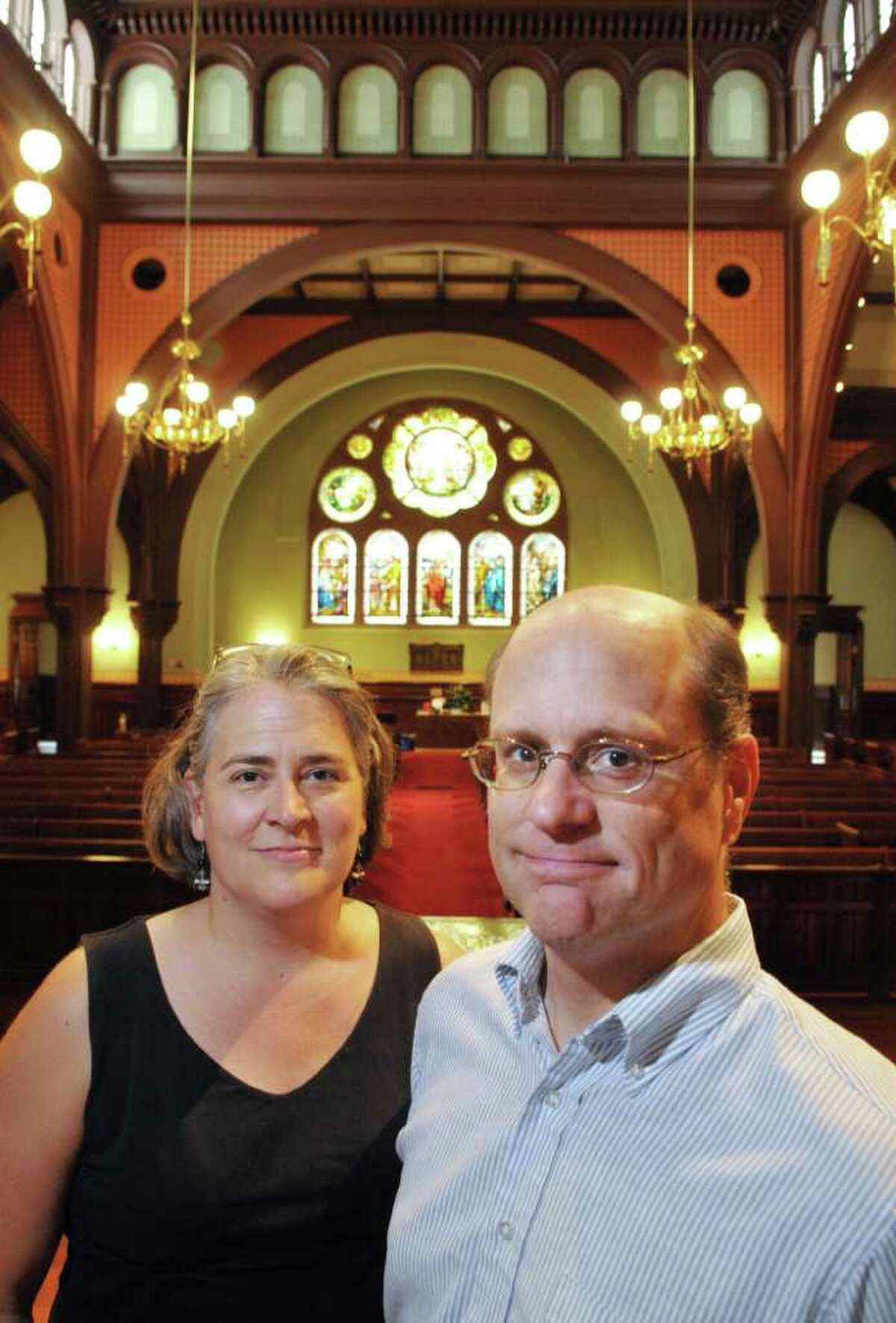 Reverends Miriam, left, and Glenn Leupold inside First Presbyterian Church in Albany Wednesday July 20, 2011. (John Carl D'Annibale / Times Union)