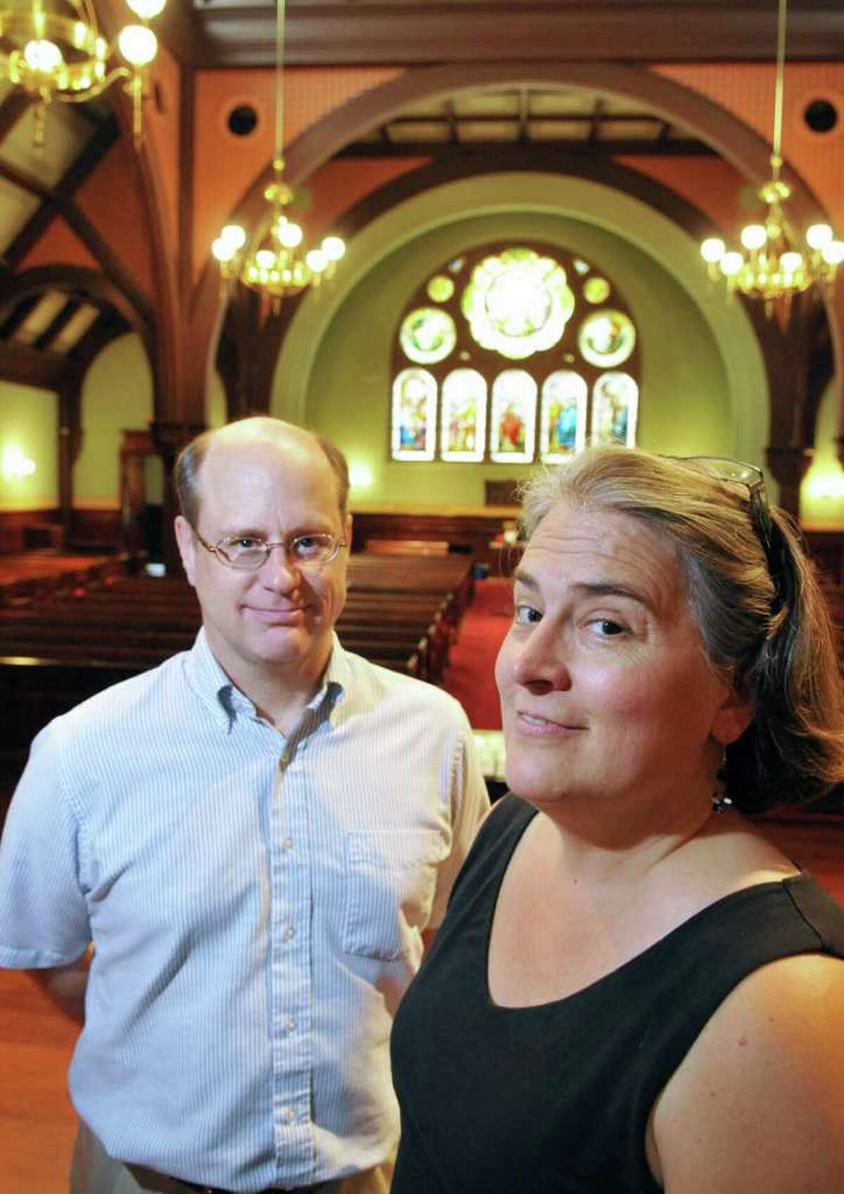 Reverands Glenn, left, and Miriam Leupold inside First Presbyterian Church in Albany Wednesday July 20, 2011. (John Carl D'Annibale / Times Union)