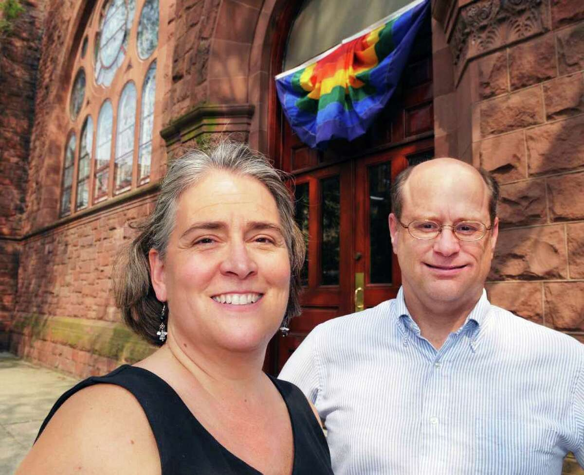 Reverends Miriam, left, and Glenn Leupold outside First Presbyterian Church in Albany Wednesday July 20, 2011. (John Carl D'Annibale / Times Union)