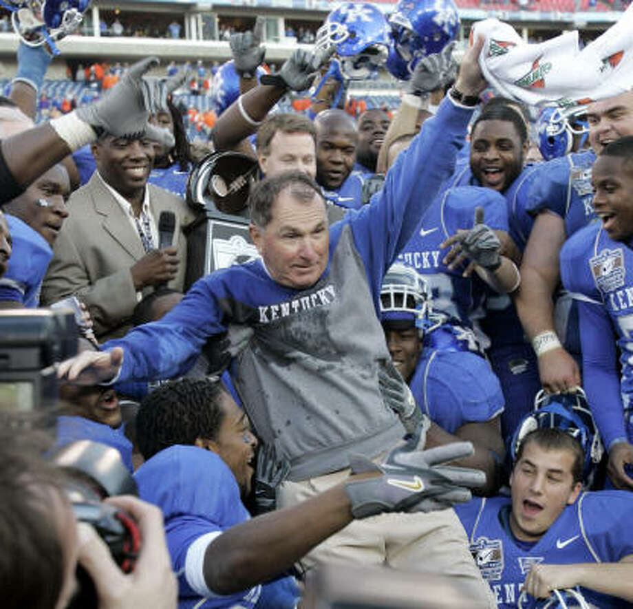 Kentucky coach Rich Brooks celebrates with his team after the Wildcats beat Clemson for their first bowl victory in 22 years. Photo: Mark Humphrey, AP