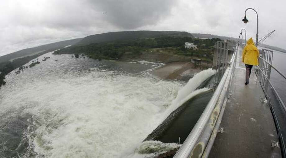 The Brazos River Authority opened three of nine floodgates on Morris Sheppard Dam on Possum Kingdom Lake, west of Fort Worth. Photo: TOM PENNINGTON, FORT WORTH STAR-TELEGRAM