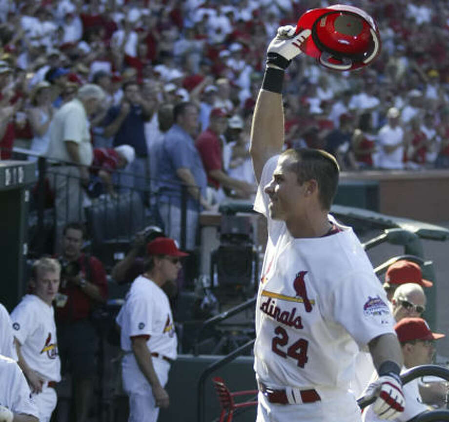 Cardinals OF Rick Ankiel answers a curtain call from Busch Stadium fans after hitting his second HR in Saturday's win. Photo: Tom Gannam, AP