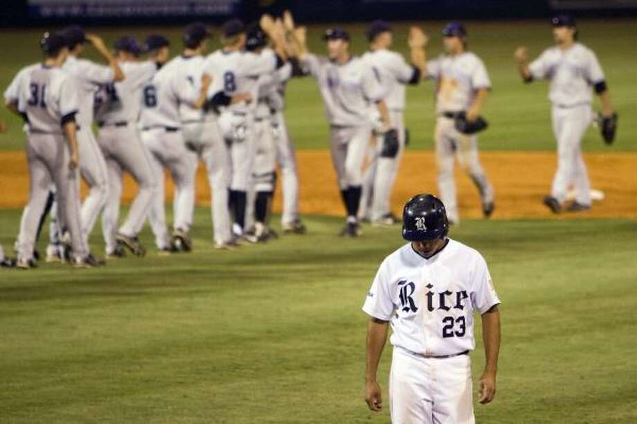 Rice third baseman Anthony Rendon walks off the field after Kansas State's 7-6 victory at Reckling Park on Saturday. Photo: Smiley N. Pool, Chronicle